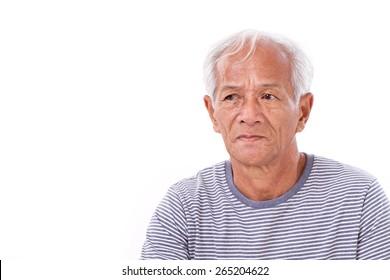old senior man suffering from eye disease, surfer's eye, pterygium, poor eyesight