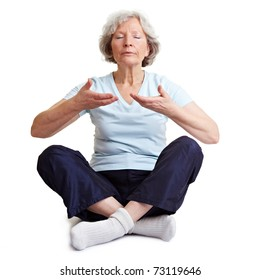 Old senior woman meditating and relaxing with breathing exercises