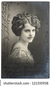 old sepia photo of young woman with signature. vintage picture from 1914