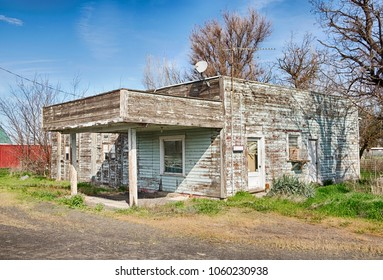 An old service station by the side of the highway in Lowden, Washington with a covered service area is gradually falling apart.