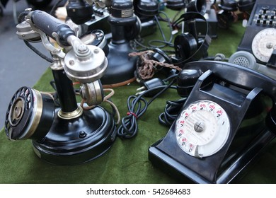 Old set of phones at market stall