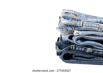 old several fashion blue jeans isolated on white