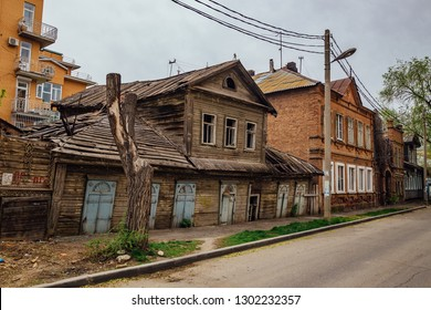 Old shabby abandoned wooden house with carved windows in old Astrakhan street