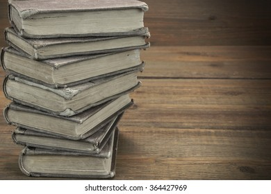 Old Shabby Books In Stack On The Wood Horizontal Background With Copy Space