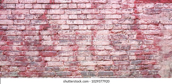 Old Shabby Concrete Grunge Wall With Peeled Plaster. Graffiti Wide Background Or Texture. Colorful Rough Building Facade With Grafiti. Abstract Web Banner For Design. Red Painted Panoramic Brickwork