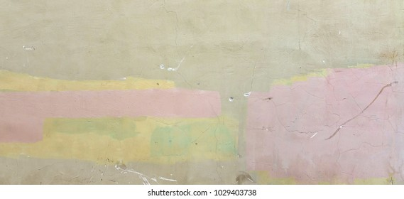 Old Shabby Concrete Grunge Wall With Peeled Plaster And Graffiti Wide Background Or Texture. Colorful Rough Building Facade With Grafiti. Abstract Web Banner For Design