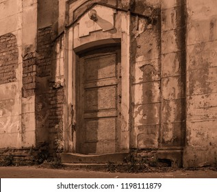 old shabby door on the street at night