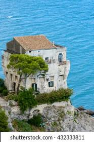An old shabby house on a cliff, Vietri sul Mare, Italy.