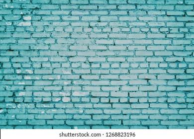 Old shabby painted brick wall. Aged brickwork texture. Blue masonry retro grunge background