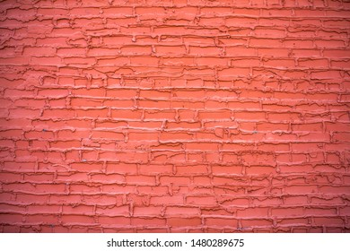 Old shabby painted brick wall