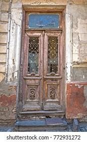Old shabby rickety door