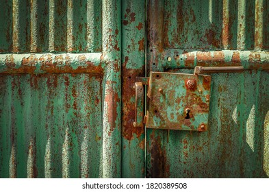 old shabby rusty green gate