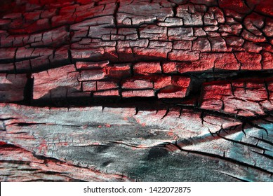 Old shabby tree trunk surface with burned stains, red palette, horizontal background texture close up detail