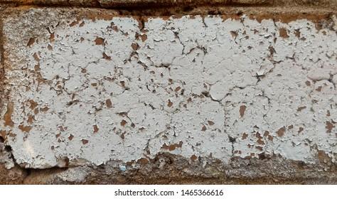Old shabby white painted brick. Grunge texture