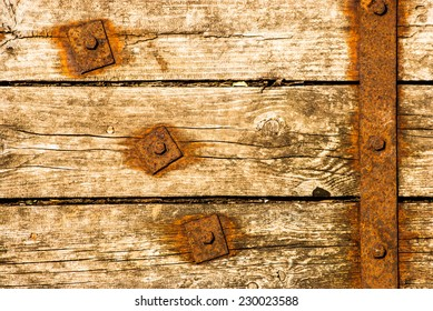 Old Shabby Wooden Planks with rusted bolts, grungy background texture
