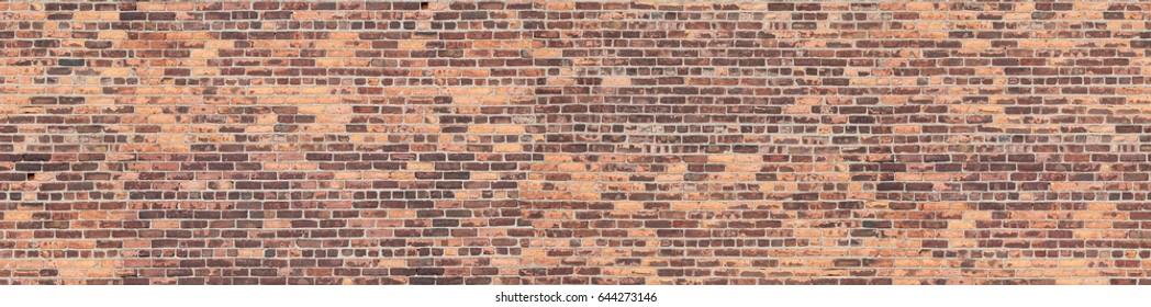 Old shabby-looking brick wall seamless texture. Hoboken. USA.