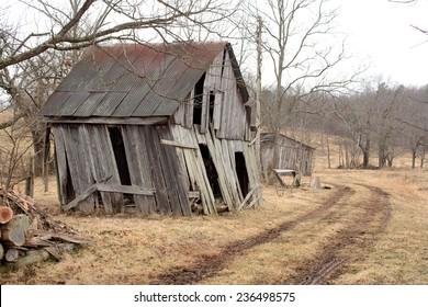 An old shack on a winter landscape.