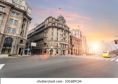 old shanghai of the bund in sunset, street scene of excellent historical buildings with city road