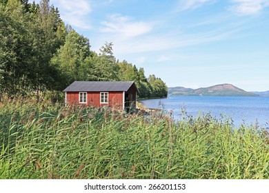 Old shed at a lake in Sweden