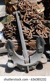 Old ship anchor with chain