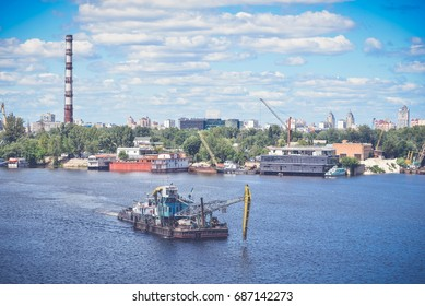 Old ship crane is on the river