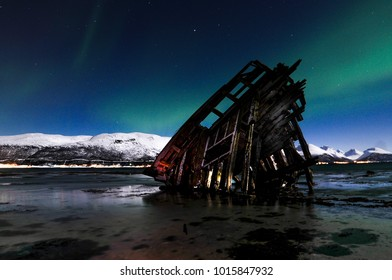 old ship on the background of the Northern lights