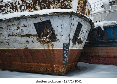 The old ship on winter sludge. Ship in a frozen river. Ships in ice.
