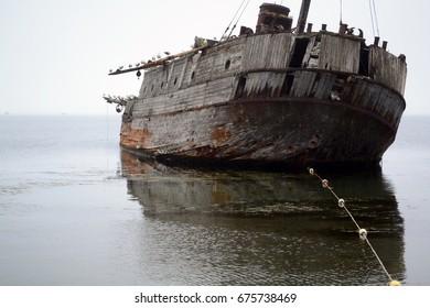 The old ship, sea, calm, sea gulls. Bay Vityaz'. Primorye. Russia.