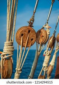 Old ship tackles. Old sailing ship vessel. Background