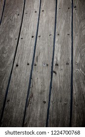 Old ship teak deck weathered and grunge, wooden texture and background