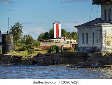Old ship tugboat in the industrial area of the shipyard in Kronshtadt