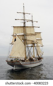 Old ship with white sales in the baltic sea