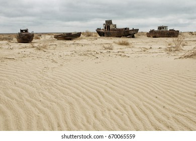 Old ships in the desert ship cemetery the consequence of Aral sea disaster, Muynak, Uzbekistan