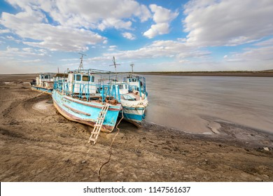 Old ships on the shore of a drying Amu Darya river, Xorazm Region, Uzbekistan