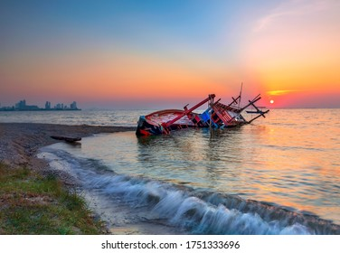 The old shipwreck was abandoned, standing on the beach. Shipwrecks at Kratinglay beach, ChonBuri, Thailand