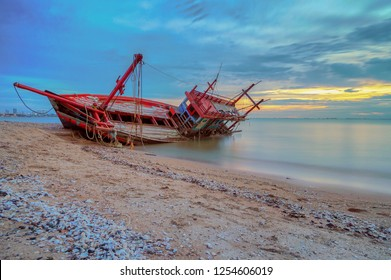 An old shipwreck boat abandoned stand on beach. Shipwreck in Kratinglay beach Chonburi Thailand.