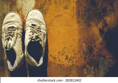 old shoes.old background. dirty shoes. grunge