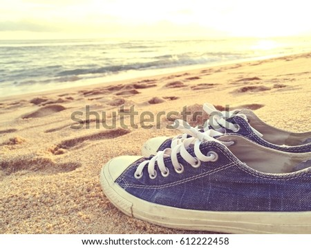 381a6527e9af Old Shoes Footprint On Sand Beach Stock Photo (Edit Now) 612222458 ...