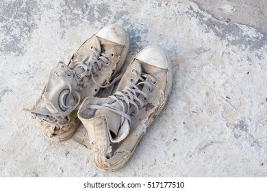 Old shoes left on the floor of the house screaming cracking.