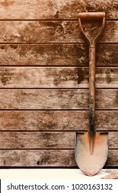 old shovel lean on wooden wall