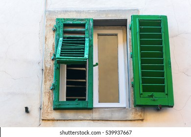 old shuttered window at a house in Florence, Italy
