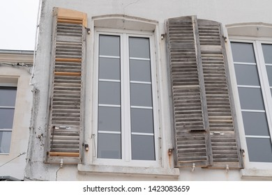 old shutters in restoration waiting for new paint