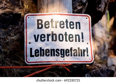 old sign in german, which means danger, keep off