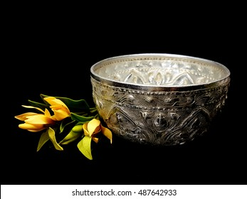 Old Silver Bowl with Sculpture flower in Black Background