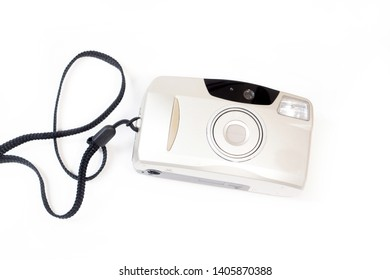 Old silver camera compact with film on white background. Vintage film concept. Compact point shoot camera.