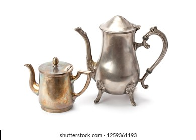 Old silver coffee pot and teapot isolated on white background.