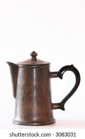 Old silver coffeepot on a white background