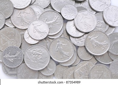 A lot of old silver french coins as background, a close up view.