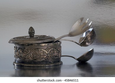 old silverware and silver box close-up