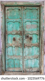 Old single rusted dark green color painted wooden door, wood door with painted color wall, Jodhpur, state of Rajasthan, India